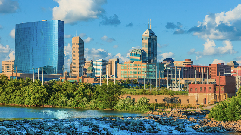 a photo looking into part of the city of Indianapolis, IN across from a river